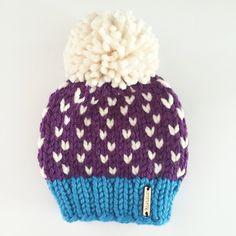 A Nickichicki custom knit beanie in the color scheme: Ocean Blue, Deep Purple and Fisherman!