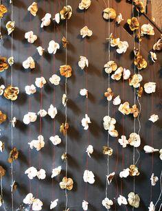 flower garland - same idea, white or gold flowers on white or gold ribbon