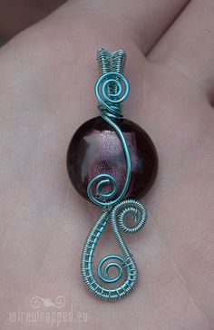 Purple and turquoise wire wrapped pendant