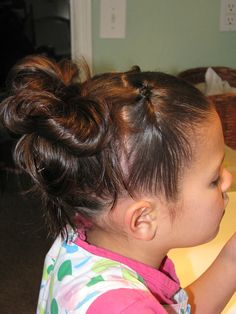 Top section is knot, bottom section is reverse knot, put all in middle section and do messy bun!