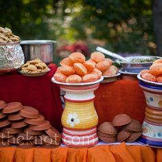 "At the mehendi party, guests dined on traditional Indian ""street food,"" including panipuris (fried dough filled with spices, chili, masala, potato, onion, and chickpeas) and chaat, a savory fried dough snack."