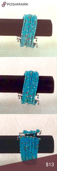 Turquoise mini-beaded multistrand bracelet Perfect and trending color this season! Turquoise miniature beads in multiple strands with accent beads randomly placed and set with wire strands. Very gorgeous. Perfect condition  🛑 No trades or lowball offers 👎🏻 My closet items aren't for personal profit, are already extremely discounted and sell very fast. So if you see things you 😍 ♥️, make an offer!  🎀 Free gift comes with every shipment 🎀 Jewelry Bracelets