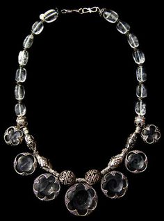I once saw one of these that had 6 more of the Chrystal beads, the big ones (and did cost about 300 bucks more) and loved that even more. If I ever were rich enough to want to posses an expensive piece of jewelry. THIS kind would be it