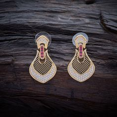 Trendy CZ Zircon Hanging earrings studded with Ruby synthetic stones, with gold Polish.