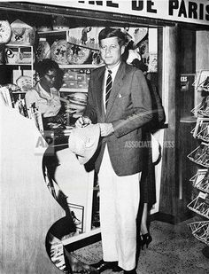 Sen. John Kennedy (D-Mass) shops for tourist hat in Montego Bay, Jamaica on April 13, 1960. He arrived at the British West Indies Island earlier in day for a vacation from his primary campaign for the Democratic presidential nomination.