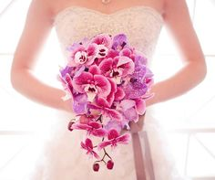 A cascading bouquet of pink and lavender orchids is ideal for the modern romantic bride. Photo By: Emily G Photography Bouquet by: Bella Bloom Florals - Sherwood, Oregon