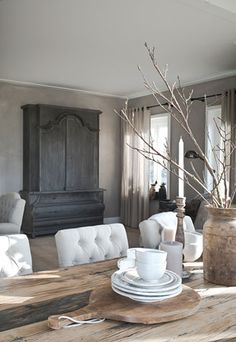 white chairs with rustic table