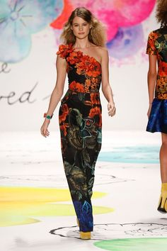 On February 13, the fall-winter 2015 Desigual fashion show took place and featured Victoria's Secret Angel Behati Prinsloo. Former ANTM alumni Chantelle Winnie also hit the catwalk. Designer Christian Lacroix was inspired by abstract paintings, photographs of Africa and flowers for the new season designs. All the models rocked curly hairstyles to go with ...