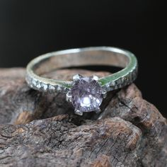 Sterling silver ring with faceted spinel gemstone set in six prong setting