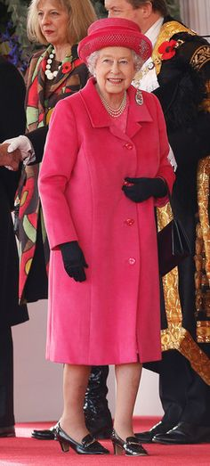Queen Elizabeth II in a hot pink outfit as she arrives for a ceremonial welcome for visiting President of South Korea at Horseguards Parade on 05.11.13 in London, England.