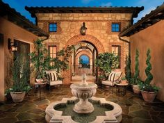 Check out the Mediterranean landscaping elements—from water fountains to wall art to stucco and stone walls—plus a plethora of covered patios and pergolas. Tuscan Garden, Tuscan House, Spanish Style Homes, Spanish House, Tuscan Style Homes, Spanish Colonial, Courtyard Design, Courtyard Pool, Hacienda Style