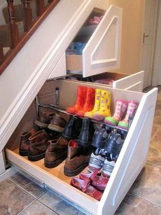The space under stairs is the most often overlooked area for storage. This homeowner took advantage of every inch with these slide outs for boot and shoe storage. Visit the blog for other clever storage solutions behind closed doors.