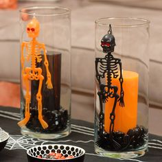 These tall glass votive holders -- complete with a black jelly bean base -- hold black and orange candles. Spooky skeletons hang on the outside of the votive holders, ensuring an extra-haunting glow when the candles are lit.