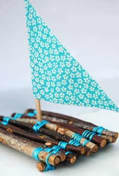 Natural Stick Boat (with folded paper napkin sail)
