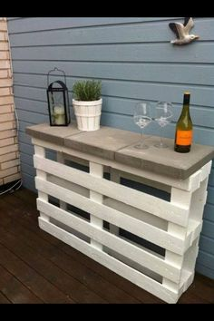 Totally doing this!! Two painted palettes and 3 concrete pavers...done! Instant bar or shelf for the patio!