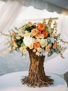 Unique table centre pieces! Vases out of recycled wood branches and a bouquet to top them - simple - rustic and chic #thecrimsonbride