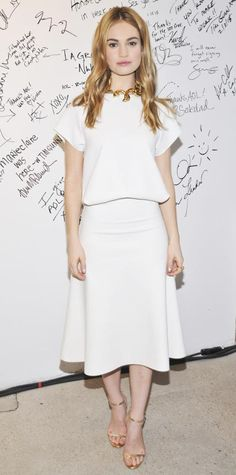 LILY JAMES in a white top and matching flared midi skirt (both Camilla and Marc), accessorized with a gold statement necklace at the AOL Build Speaker Series in N. (See all her best Cinderella tour looks here. James White, Lily James, Midi Flare Skirt, Princess Style, Celebrity Look, Celeb Style, Red Carpet Dresses, Night Looks, Red Carpet Looks