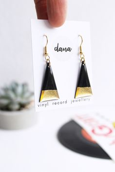 A pair of modern geometric dangle earrings in black and gold that will surely get you noticed handcrafted by designer jeweller Anne-Louise Laflamme in her studio in the beautiful south west of Ireland, from a recycled vinyl record. Keep it simple. Handcrafted Jewelry, Unique Jewelry, Simple Bracelets, Minimalist Earrings, Gifts For Women, Jewelry Collection, Jewerly, Jewelry Design, Modern