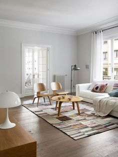 Scandinavian chair in minimalist setting. Eames Plywood Chair replica in natural color.