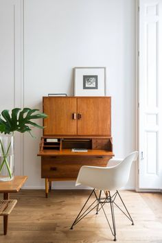 Midcentury Style Office Desk and Cabinet Workspace with Retro White Seating