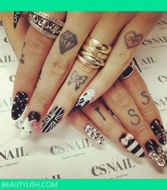 I could do without the tatoos, but the nails are nice!  Not exactly classy, but not too hood....
