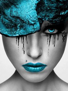 See through effect of hat and turquoise color also found in colorful see through table.