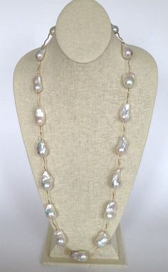 White Fresh Water Baroque Pearls Necklace, 14k Gold | May 23, 2015 Auction at Rafael Osona Auctions Nantucket, MA