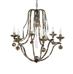 Nothing enhances the mood of a space quite like an extraordinary chandelier. Elegantly swooping iron, oversized Italian crystals and 6 light fixtures