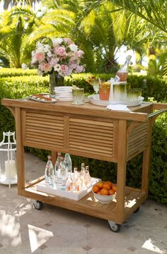 From top to bottom, we designed this handsome teak cart to be the ultimate outdoor beverage center.