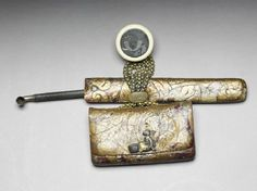 Tobacco pouch, pipe, and case, attached to a netsuketop, pipe.  Ashmolean Museum.