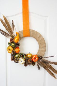 I love a beautiful fall wreath on the front door at this time of year. With pumpkins, gourds, pine cones, and pheasant feathers, this rustic DIY wreath screams fall! Fall Crafts, Holiday Crafts, Diy And Crafts, Fall Wedding Decorations, Thanksgiving Decorations, Diy Thanksgiving, Elegant Fall Wreaths, Diy Wedding Projects, Pumpkin Decorating