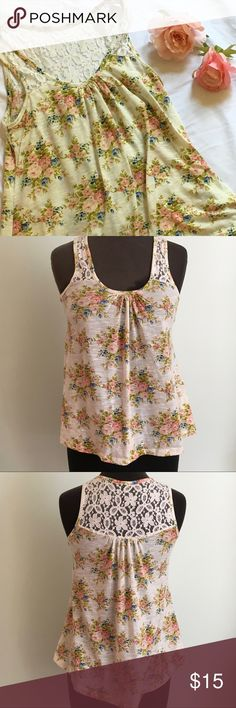Kirra M floral and Lace Tank Top Kiera M floral and Lace Tank Top. Romantic style tank top with lace back and straps. Self:100% Polyester Contrast: 80% Cotton 20% Nylon. Fits a size (6-8) Kirra Tops Tank Tops