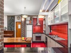 Exposed brick in a kitchen design from an Australian home - Kitchen Photo 7183685