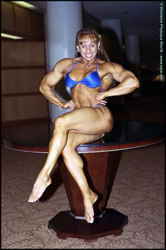 IFBB Pro female bodybuilder Betty Viana-Adkins posing her awesome muscles for WPWMAX!