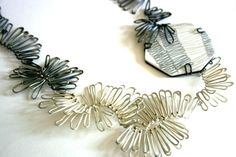 Prudence Horrocks, Edinburgh College of Art; - Necklace in silver and 9ct gold set into acrylic