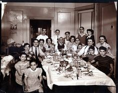 Italian Family Eating Dinner and there were that many at the table. Bring back the good old days! I have photos of famiglia just like this.