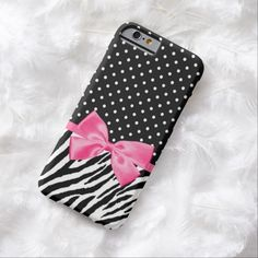 A cute black and white zebra print with a chic polka dot pattern slim #iPhone6case embellished with a chic hot pink ribbon tied into a girly bow. This modern and girlie animal print and polkadot fashion accessory is a flat printed image and does not contain an actual ribbon.