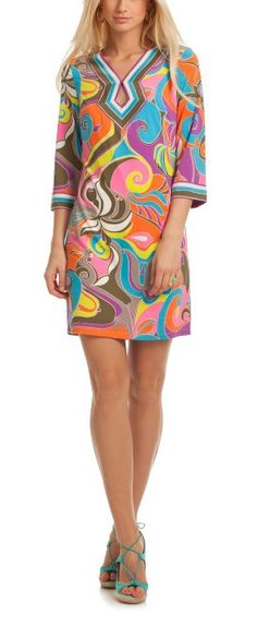 For a stylish good time, look no further than the Kaylan Dress. In bright hues, this matte jersey tunic dress delivers in an iconic swirl print. With a unique geo neckline and striped border detail, i