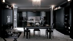 new backdrop for the most ancient of traditions: this sums up Baccarat in black gloss lacquered version. A kitchen for classy interiors with unusual pillar fronts, bevelled plate glass, metal inserts, metal or methacrylate handles and boiserie panels.