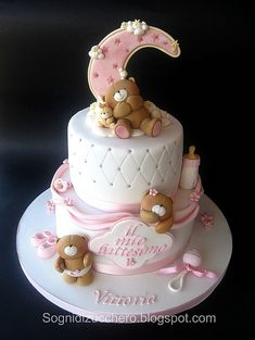 Baby bear cake~                          by Sogni di Zucchero, via Flickr, pink, white, Brown teddy bear, quilt, baby bottle, baby booties, pacifier, rattle, 2 tier round