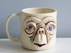 PHONE HOME. ALSO CAN YOU PUT SOME COFFEE IN THIS MUG, THANK YOU.