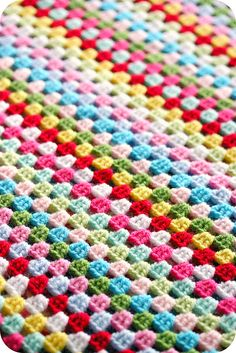 Love the bright colors. Could make this in rows or in a giant Granny Square.