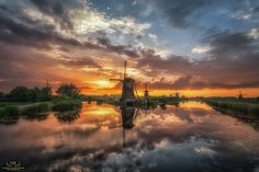 """The 16th of June 2016 at Kinderdijk was one of those sunsets that I'll never forget. Calm water, beautiful clouds and the sun painting the sky with stunning colors.  Best viewed in black (click image or press """"M"""")"""