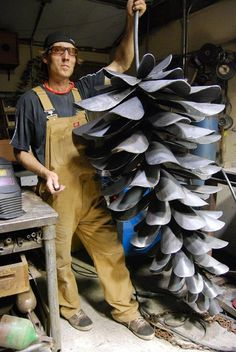 Could add pine needles. amazing giant fir cone sculpture made from old shovels, by artist Floyd Elzinga. would be beautiful in the garden Metal Yard Art, Scrap Metal Art, Sculpture Metal, Art Sculptures, Sculpture Ideas, Abstract Sculpture, Garden Sculpture, Metal Art Projects, Welding Art