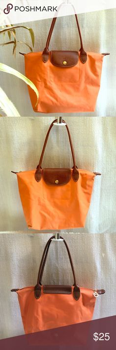 "💕Medium Le Pliage Longchamp Made in China Used and shows normal use but this classic bag remains a ""must have bag"".  Authentic and the striking orange color will make you stand out from the crowd. Bottom shows signs of use but still in very good condition. Handles are made of leather and in perfect condition. Longchamp Bags Mini Bags"
