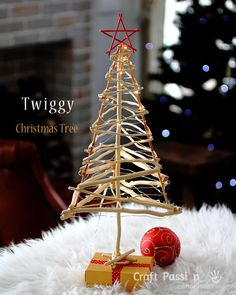 We could do two of these for the xmas table. They could be made of rustic sticks and be maybe 30 cm high.
