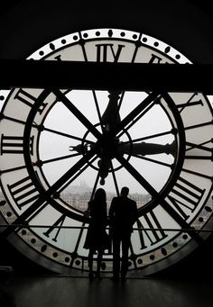 Kate Middleton Photos Photos - Britain's Prince William, Duke of Cambridge, and his wife Britain's Kate, Duchess of Cambridge, look across the River Seine at a view of Paris through the clock face at the Musee dOrsay - the former Gare d'Orsay train station- during their visit to the museum on March 18, 2017 on the second day of their two-day visit to the French capital. .It is the prince's first official visit to the French capital since his mother Diana died there in a car crash in 1997…