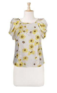 I love this blouse! I think with a gray pencil skirt it would make such a cute work outfit.