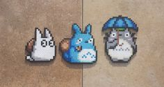 "Handmade Perler bead sprite featuring the white Totoro, blue Totoro, and the big Totoro from the movie ""My Neighbor Totoro""~! They're too cute! I can't look away!   I fo..."