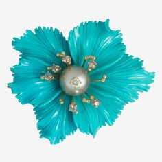 A turquoise, cultured pearl, colored diamond and eighteen karat gold brooch, Grasso